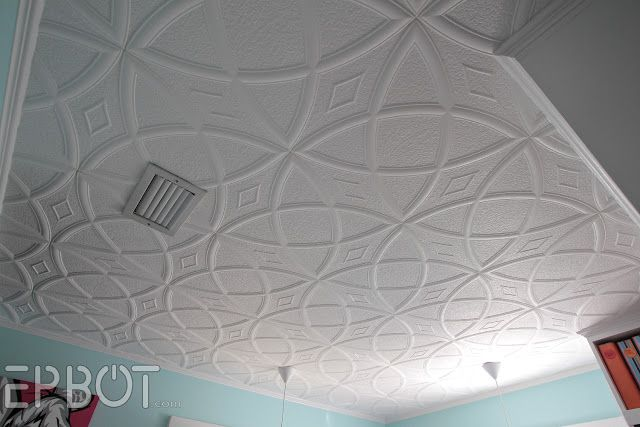 These are Styrofoam ceiling tiles you can glue up right over popcorn ceilings! No prep work required!