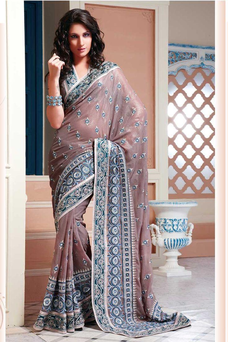 Like: colours (lilac, blue, white), blouse design (neckline, border)