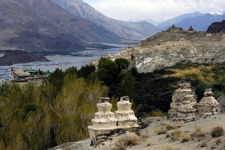 Crumbling chortens dot the hilllside around Ensa Monastery high above the Nubra River valley. Image by Amar Grover / Lonely Planet.
