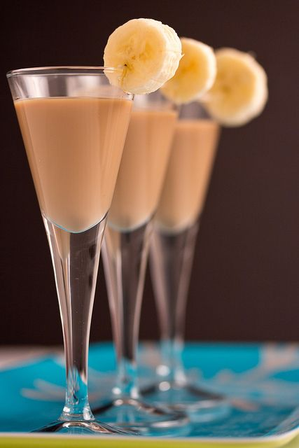 Whoville Effect Banana Shot - Ingredients: 3 ounces dark chocolate liqueur, 2 ounces creme liqueur, 1 ounce creme de banana, 1/2 ounce spiced rum. Instructions: Pour ingredients into a cocktail shaker, stir, and serve into shot glasses.  Garnish with a banana slice.