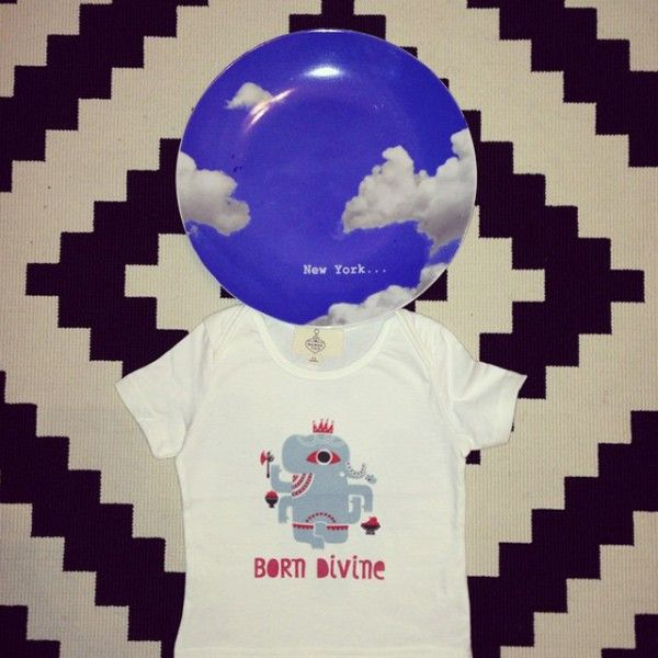 "We love the way Nearchos Ntaskas depicted baby ganesh on this ""Born Divine"" Baby tee"