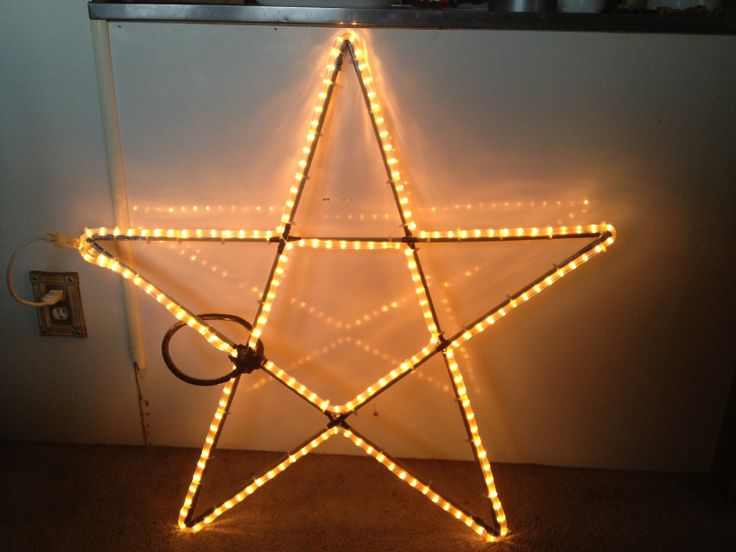 Outside star, for my shooting star. Made with dowel rods, duct tape, zip ties and rope lights,