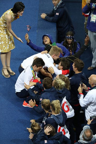 #RIO2016 Gold medalists Jack Laugher and Chris Mears of Great Britain celebrate with team members during the medal ceremony for the Men's Diving Synchronised...