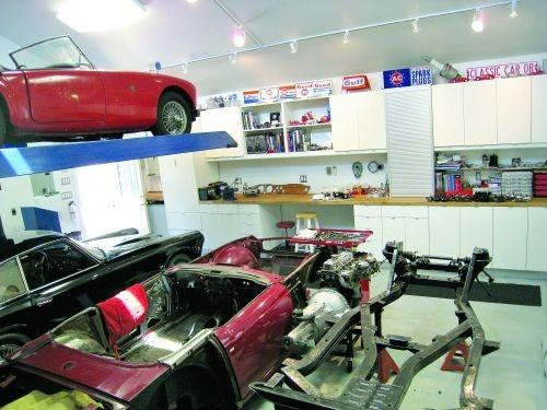 Four vehicles in a two car garage, with the assistance of Bendpak lift.