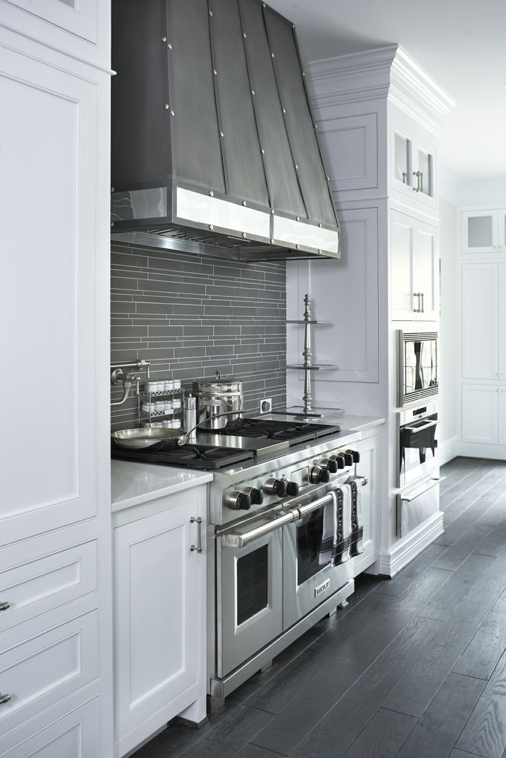 Statement making elements custom vent hood kitchen for Kitchens by design