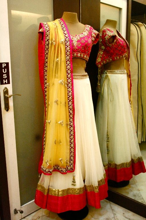 White half saree with pink and gold border, pink blouse with silver work and yellow oni/ dupatta with work.