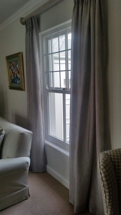Lined pinch pleat curtains on wooden recessed track with paint effect.