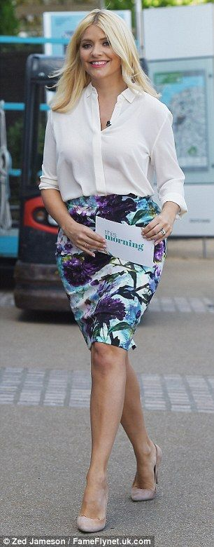 Summer star: Holly Willoughby looked beautiful as she filmed This Morning on London's South Bank on Tuesday wearing a pretty floral pencil skirt