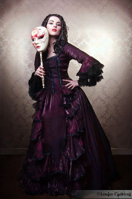 Purple Victorian Masquerade Ball Gown/Evening Gown/Dress (with venetian mask on a stick) - For costume tutorials, clothing guide, fashion inspiration photo gallery, calendar of Steampunk events, & more, visit SteampunkFashionGuide.com