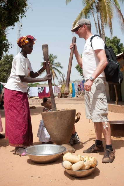 Gambian lady and tourist in Jufureh. The Gambia is very popular with UK holidaymakers. The majority visit for winter sun, bird-watching and excursions, as well as the nightlife around the tourist resorts.