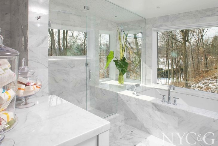 This Sleepy Hollow bathroom was graced with abundant natural light and bucolic views. Architect Jo Machinist reconfigured the 175-square-foot space, incorporating a shower/steam room, a toilet enclosure, a large tub, and built-in storage.