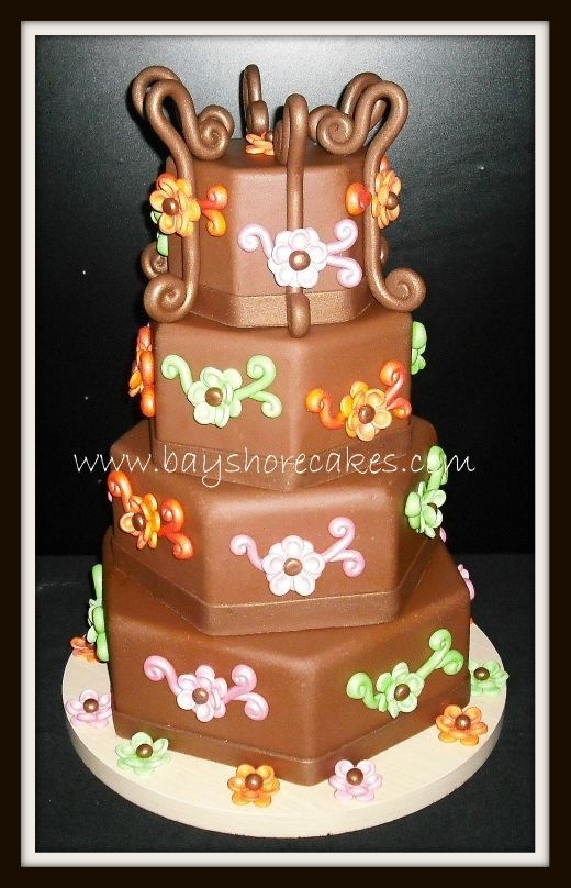 4 tier Chocolate MM fondant hexagon wedding cake with Pink, Orange, and Green