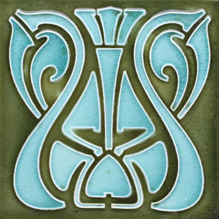A relief pressed Art Nouveau tile with a stylised whiplash design in pale blue on an olive-green ground. Condition: typical...