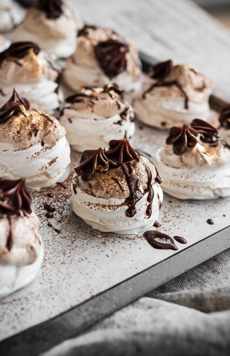 Mini pavlovas with hazelnut cream and dark chocolate ganache.