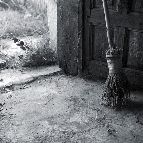 A Witch's broom - Besom - is always round, not flat ~ and it is not used for sweeping the dirt from the floor - actually, the bristles don't even need to touch the floor - the Besom is used to sweep away negativity and all that is not wanted during a ritual...