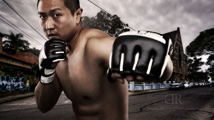 MMA fighter Alan Tran in graffiti covered street throwing punch.  See more of my work at www.deanrichter.com.au.
