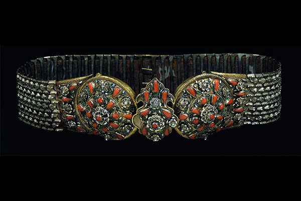 Enamelled & Gilded Wedding Belt Greece  19th century This fine buckle was made for a wedding - for the groom to present to his bride.  It is of gilded nickel, gilded silver, enamel and glass paste stones. The metal plates of the belt are attached to woven fabric.