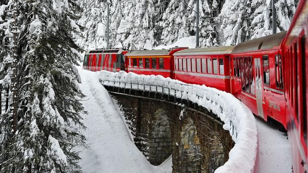 Rhäetian Railway, a scenic 240km passenger train route that runs from Thusis, Switzerland to Tirano, Italy. With Swiss pass (link in article) kids travel free with adult!!