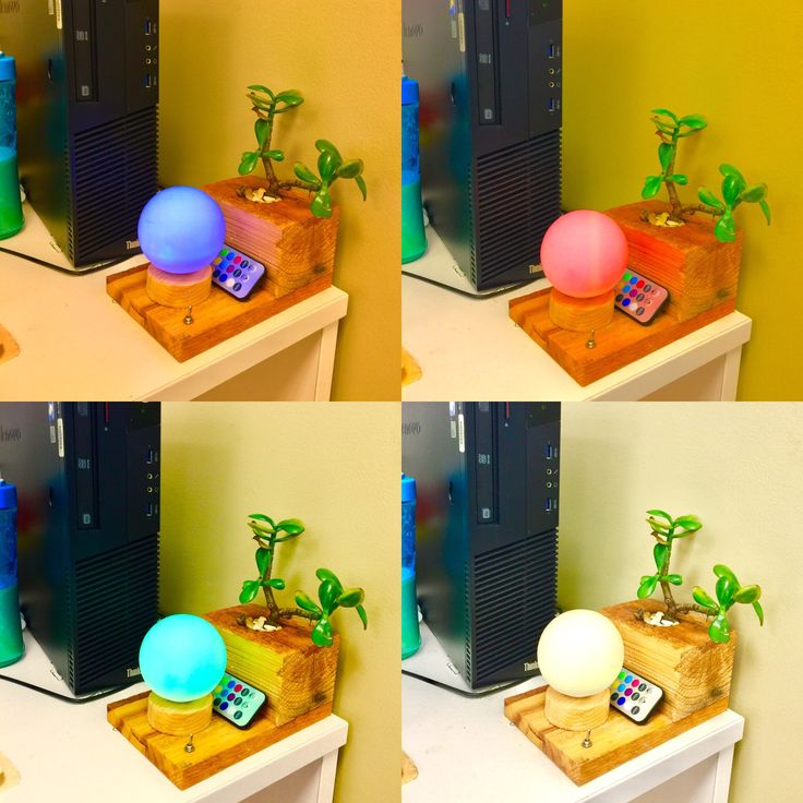 My Desk Accessory piece that I made from a recycled wood pallet feet block.It has real succulent and the globe light changes colours via remote