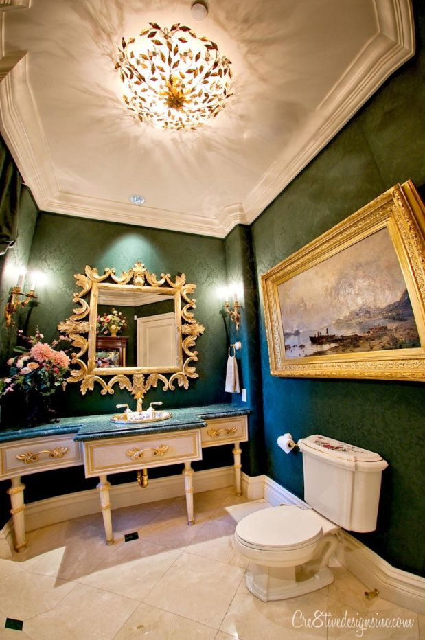 Gorgeous emerald green and gold powder room