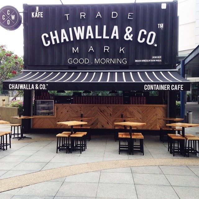 This container coffee spot is just asking for you to come and sit with it's welcoming design and layout. #Coffee #NationalCoffeeDay #RetailDesign