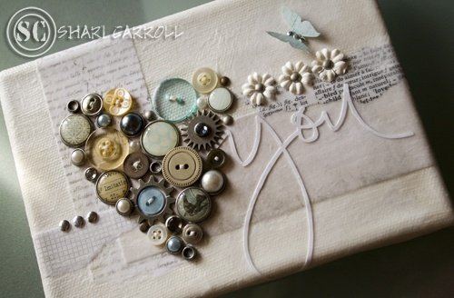 Hot glue gun buttons onto plain neutral wrapping paper for a unique touch