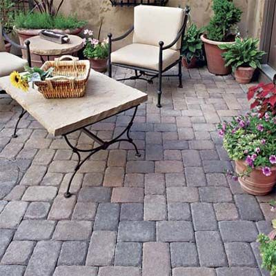 With a cool matte palette and well-worn artisanal look, tumbled pavers are an especially good match for adobe or stucco houses. | Photo: Pavestone | thisoldhouse.com