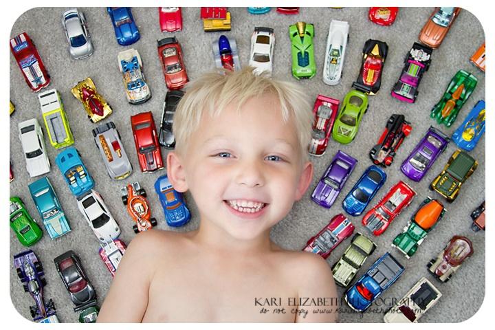 Kari Elizabeth Photography  boy posing with cars