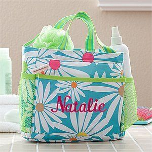 Personalized Shower Caddy - Daisies by PersonalizationMall.com. $29.95. This stylish Classic Daisy Shower Caddy will be skillfully embroidered with any initial.......calling it hers alone!Perfect for college dorm rooms or keeping bathroom essentials handy in one organized location. This grab-and-go tote is perfect for every day use, equipped with drainage holes allowing it to be brought into the shower. We artfully embroider any single initial, creating a signature look...