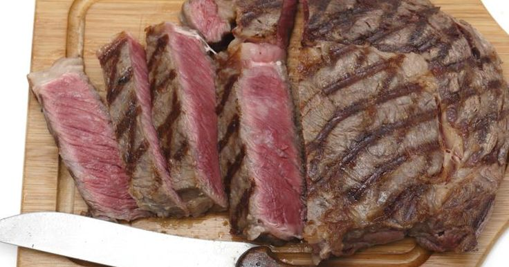 The heady flavors of steak aren't just for special occasions; cooking a blade steak brightens even an ordinary weeknight. Less-expensive cuts, such as the blade steak, satisfy an appetite for red meat and respect your wallet. Also known as a petite steak and top chuck steak, this less-celebrated cut comes from the shoulder blade. A line of...