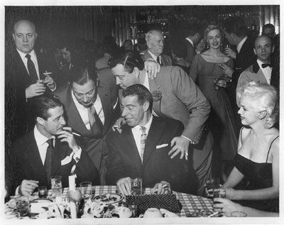 Marilyn with Joe at Jackie Gleason's party at Toot Shor's in New York, 26 February 1955.