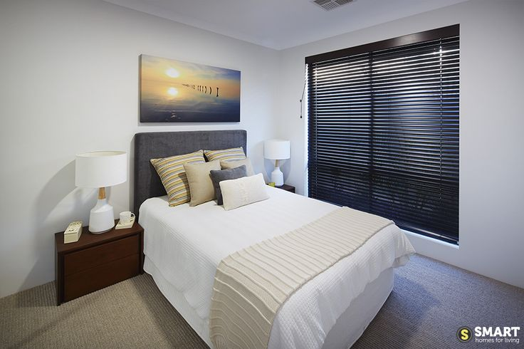 Another beautifully styled bedroom, featuring warm highlights and neutral tones.