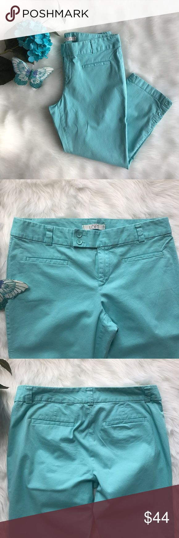 LOFT Marisa Cropped Chinos Great condition. Light signs of wear on the buttons. Size: 6. Color: Aqua/Turquoise.  Features: cropped, belt loops, buttons on bottom of leg, welt pockets. Closure: 1 jigger button, 2 front buttons, front zipper. Measurements: see pic #6. Note: 1 small stain on the back of the right leg (pic #5). Last picture is provided for fitting purposes. LOFT Pants Ankle & Cropped