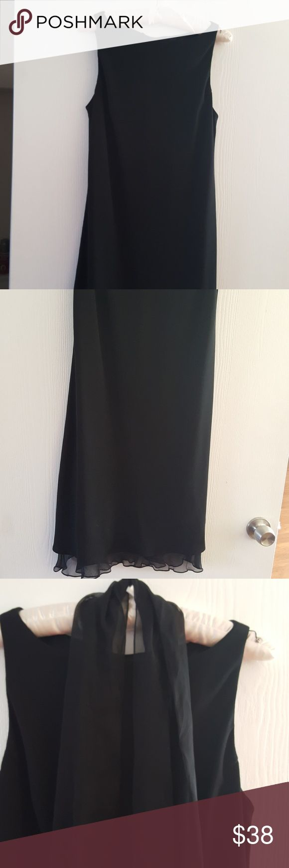 Jones New York size 12 simple black dress with she Jones New York simple black dress with fluted sheer bottom and removable scarf.  Great for reunions holidays weddings  very simple classy yet dressy . Also includes snap enclosures  to hide your bra straps! EUC.  Smoke-free pet-free home Jones New York Dresses