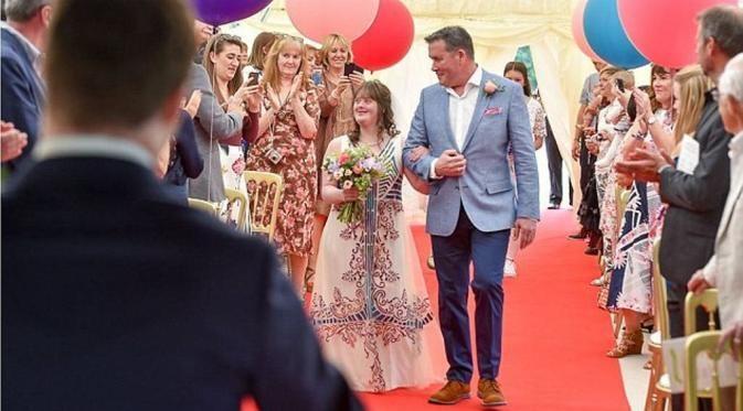Pasangan Penyandang Down Syndrome Mewujudkan Pernikahan Impiannya - http://wp.me/p70qx9-7tu