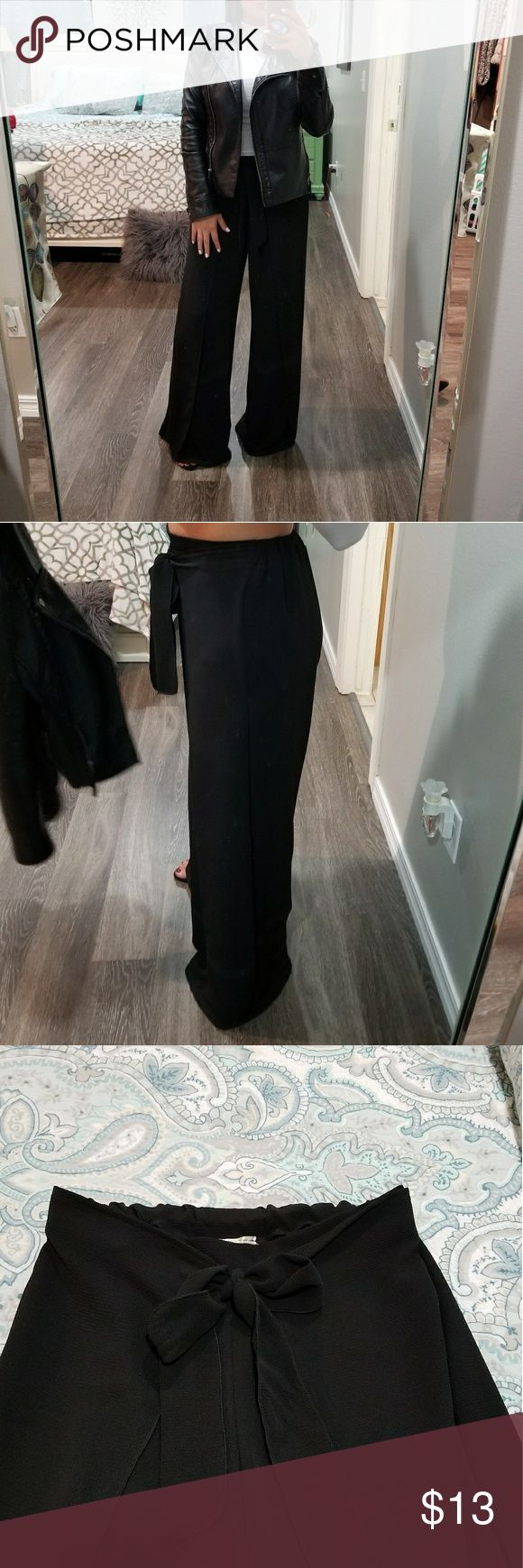 """Black palazzo pants Black palazzo dressy pants. Just bought and only worn twice. Pic #1 is how I wore it to work. I also wore to a party with a sparkly crop top! Styling these pants are endless! Posted a pic of them in neutral color so you can better see the detail of the same pants in black.   💜waist is elastic and very stretchy. I stretched them out as far as 17"""" to see how far they would actually stretch. 💜full length is about 40"""" long.  💜Bundle and save!! 💜or make offer! love nation…"""
