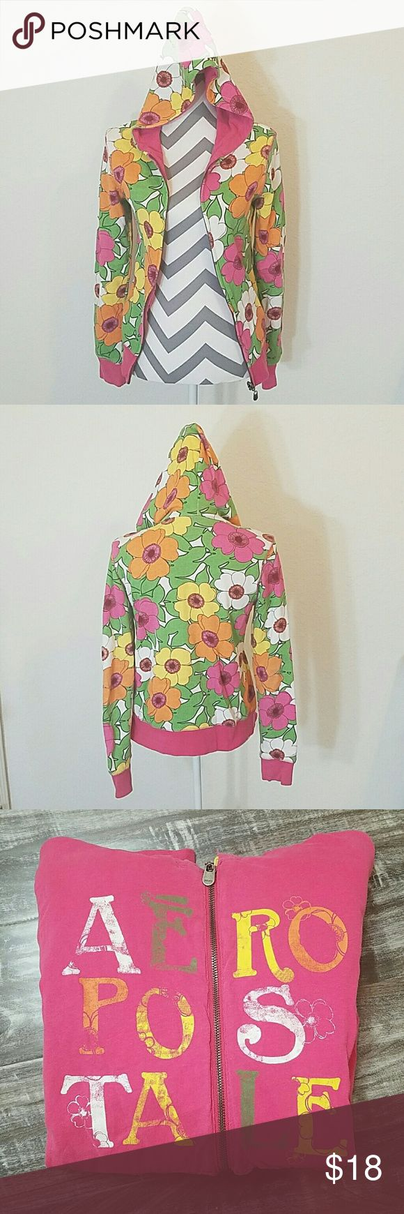 Reversible Aero Zip Up Sweater Wear as bright floral zip up or pink Aero Zip up. Worn 2 times. No stains or tears. Like new condition! Aeropostale Sweaters