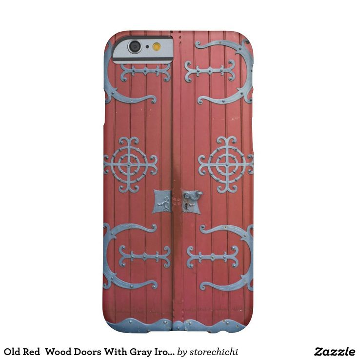 Old Red  Wood Doors With Gray Iron Supports