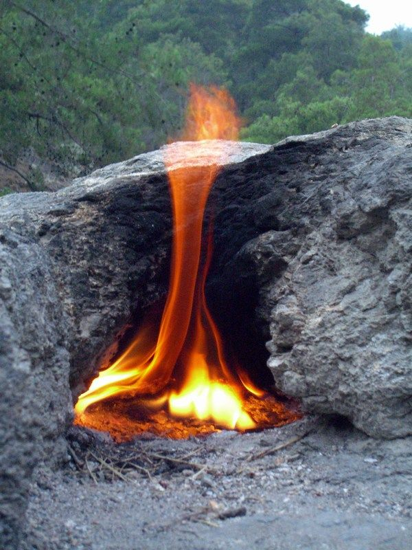 Eternal Flame --- Chimaera in southern Turkey where gas coming out of the rock self-ignites on contact with air.