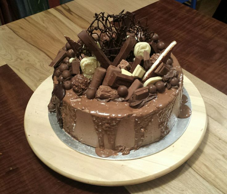 Chocolate cake with chocolate swiss meringue buttercream filling over flowing with chocolate.