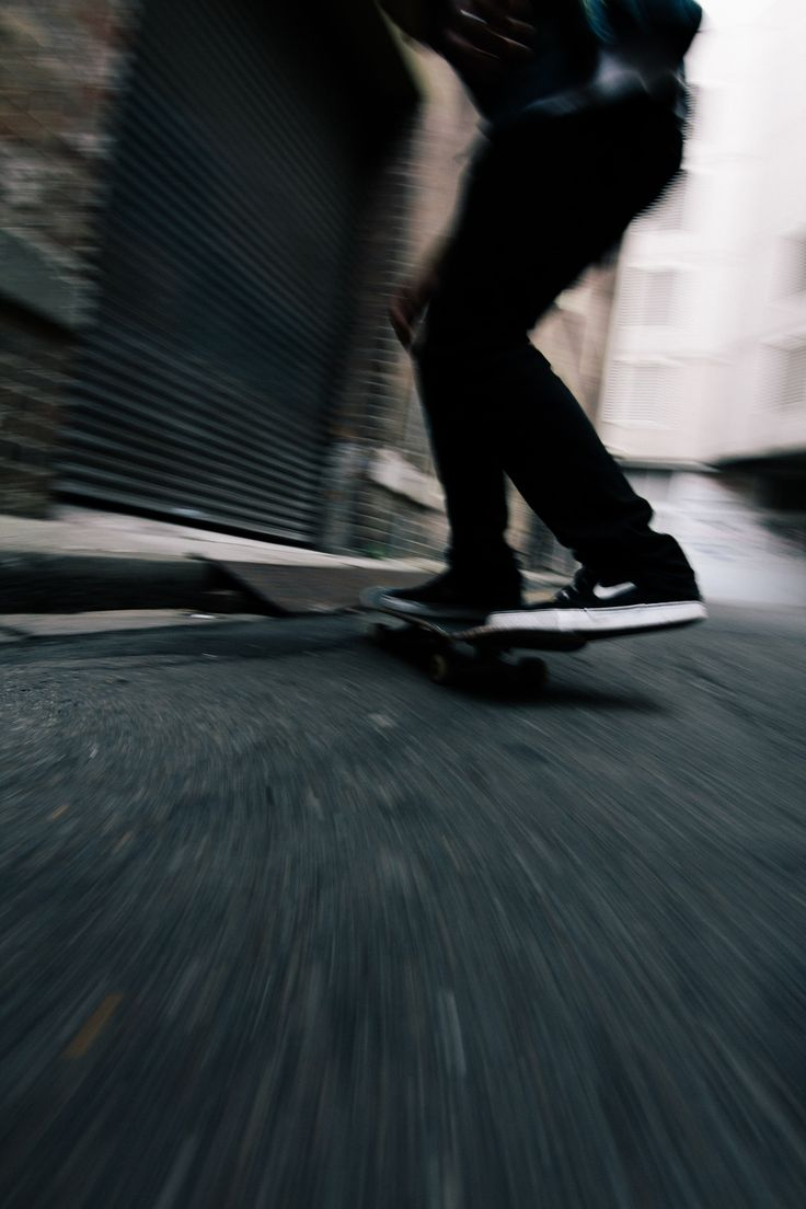My body glides along in freedom,  And  my foot keeps up the pace  While I come racing to the curb ready to flip /Asiaskate/