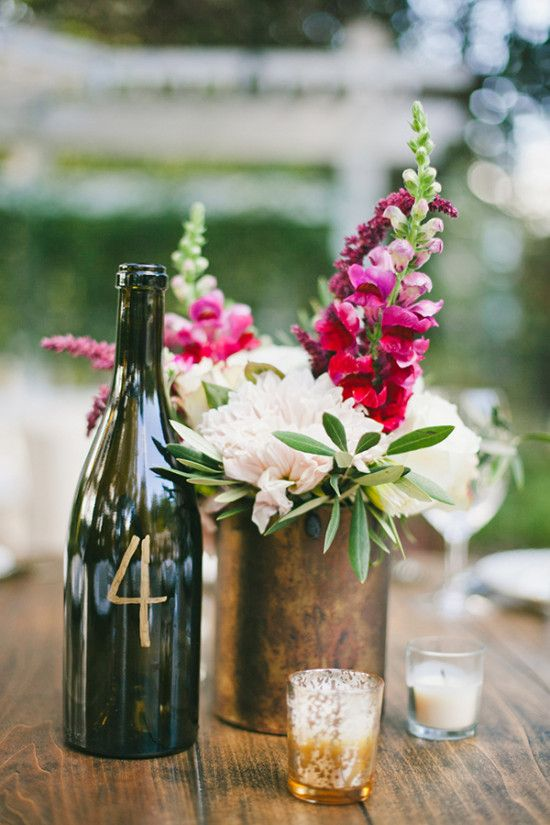 Give your old wine bottles new life by turning them into table numbers! A little gold marker goes a long way.