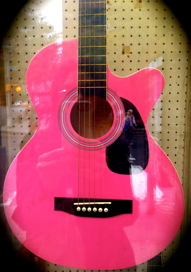 Pink guitar in a pawn shop.....I BOUGHT IT!!  www.bempoweredbwell.com photo by bmoufarrege