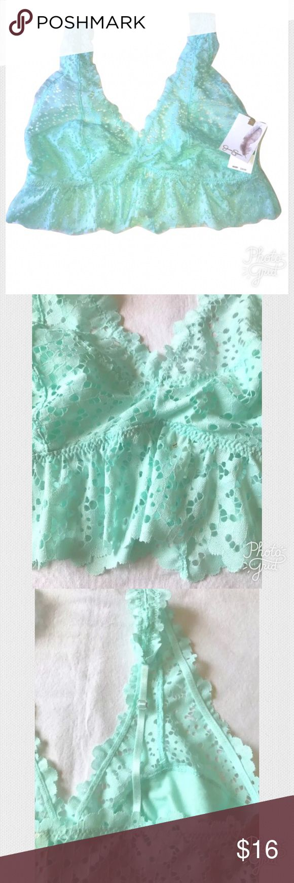 NEW Eyelet Ruffle Triangle Bralette NEW Jessica Simpson Eyelet Ruffle Triangle Bralette Soft Mint Green SIZE Large MSRP on tag is $28  I try my very best to capture the correct shade.  The actual may vary a bit in person.  Open eyelet fabric, the actual cup area is lined  Pull on style  Unpadded  Adjustable skinny shoulder straps  Size Large  88% Nylon. 12% Spandex  Thank you so much! Jessica Simpson Intimates & Sleepwear Bras