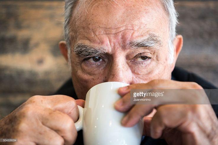 Stock Photo : Old man having coffee or tea