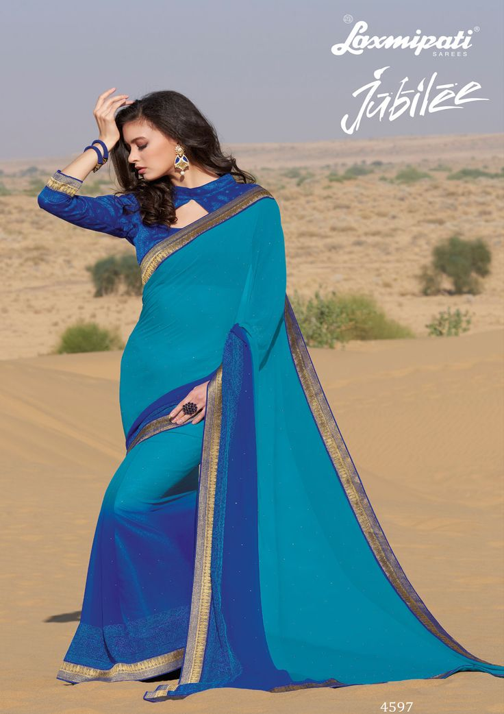 Shop this striking blue colored #georgette #embroidery diamonds work #saree and blue brocade blouse along with zari work lace border from #LaxmipatiSarees.  #GoodFriday #Ethnicfashion #Jubilee0417