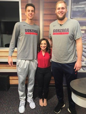 News castor Clair Graham with Gonzaga basketball players.