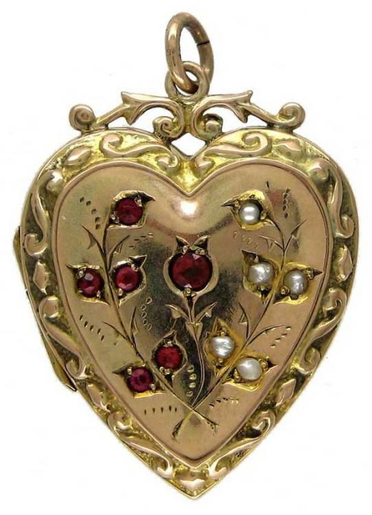 An Edwardian Heart-Shaped Gold Locket with Garnet & Pearl Decorative Features  An Edwardian heart-shaped locket with a pretty floral design and made to hold two photographs inside. Stamped 9ct on the back.