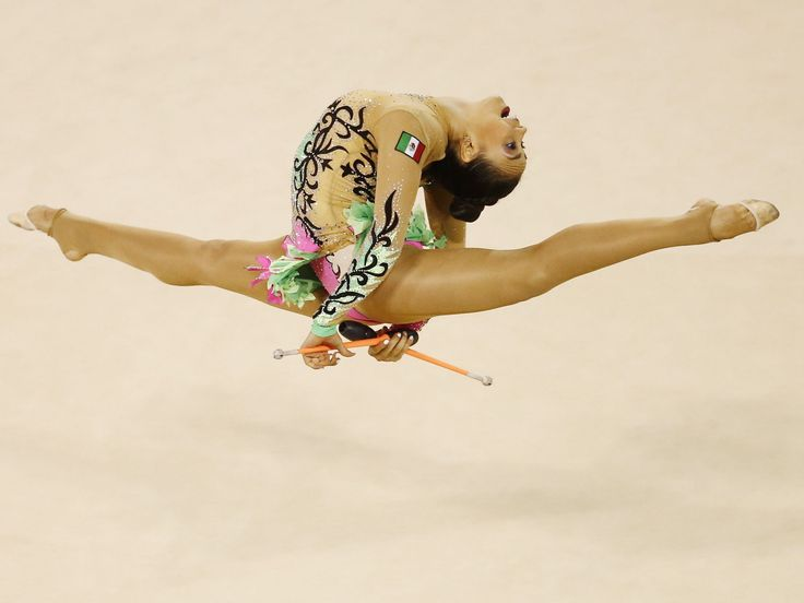 Rut Castillo of Mexico competes in the rhythmic gymnastics clubs final.  Rob Schumacher, USA TODAY Sports