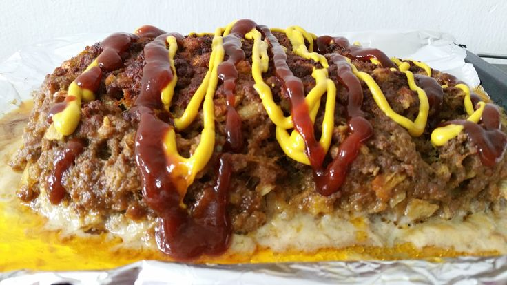 home cooked meatloaf with bbq and mustard sauces